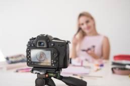 Blonde influencer recording make up tutorial