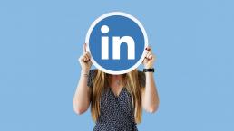 Girl-holding-LinkedIn-Sign