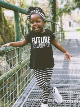 young girl on bridge t shirt saying future leader